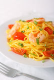 Spaghetti with prawns and cocktail tomatoes Stock Photography