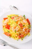 Spaghetti with prawns and cocktail tomatoes Stock Image