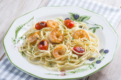 Spaghetti with prawns and grape tomatoes Stock Photos