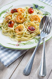 Spaghetti with prawns and grape tomatoes Royalty Free Stock Image