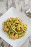 Spaghetti with Prawns and Pesto Stock Photos