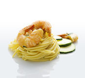 Spaghetti with prawns and zucchini. On white Stock Photo