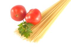 Spaghetti preparation. Spaghetti ingrednients: pasta, tomatoes, garlic, herbs Stock Photo