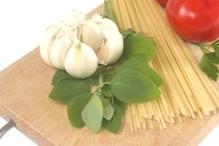 Spaghetti preparation. Spaghetti ingrednients: pasta, tomatoes, garlic, herbs Royalty Free Stock Photography