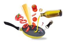 Spaghetti preparation and flying vegetables royalty free stock images
