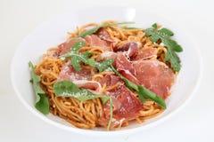 Spaghetti with prosciutto and parmesan Stock Image