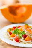 Spaghetti with pumpkin Stock Images