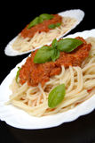 Spaghetti ragu alla bolognese sauce on black,close up Royalty Free Stock Images