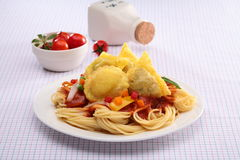 Spaghetti Ravioli with fried wonton and tomato on white plate Royalty Free Stock Photography