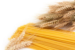 Spaghetti raw and mature ears of wheat. Spaghetti raw against the backdrop of mature ears of wheat Stock Images