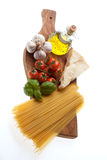 Spaghetti recipe. Arrangement of the basic ingredients for the real italian spaghetti Royalty Free Stock Photography