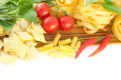 Spaghetti with red pepper, a basil and a tomato Royalty Free Stock Photos