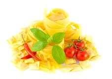 Spaghetti with red pepper, a basil and a tomato Stock Images