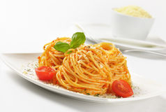 Spaghetti with red pesto and parmesan cheese Stock Image