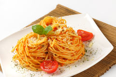 Spaghetti with red pesto and parmesan cheese Royalty Free Stock Photography
