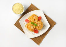 Spaghetti with red pesto and parmesan cheese Stock Photography
