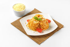 Spaghetti with red pesto and parmesan cheese Stock Images