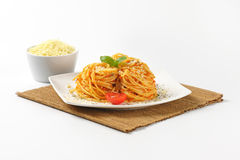 Spaghetti with red pesto and parmesan cheese Royalty Free Stock Photos