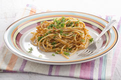 Spaghetti with red pesto and parsley Stock Photo