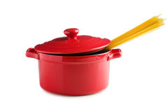 Spaghetti in a red pot Stock Photos