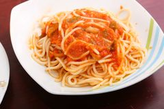 Spaghetti with red sauce. Spaghetti pasta with red sauce served on white plate Royalty Free Stock Photo