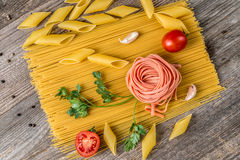 Spaghetti, rose looking macaroni in composition, topview Royalty Free Stock Photography