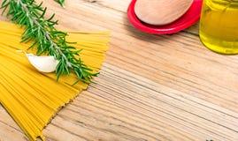 Spaghetti and rosemary royalty free stock image