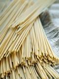 Spaghetti on sackcloth Royalty Free Stock Images
