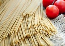 Spaghetti on sackcloth Royalty Free Stock Photos