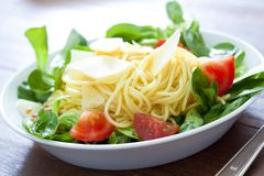 Spaghetti with salad Stock Photo