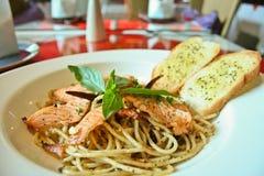 Spaghetti salmon and black pepper Stock Photos