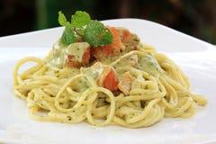 Spaghetti and salmon in pesto sauce Stock Image