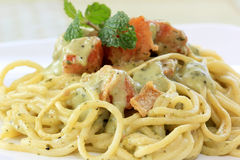 Spaghetti and salmon in pesto sauce Stock Images
