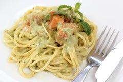 Spaghetti and salmon in pesto sauce Stock Photo
