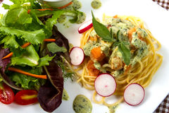 Spaghetti salmon. With pesto sauce and salad Royalty Free Stock Photos