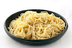 Spaghetti with Salt and Pepper. Spaghetti with salt, ground black pepper and butter.  A simple side dish Royalty Free Stock Photos