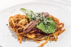 Spaghetti sardela fotografia stock