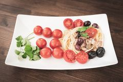 Spaghetti with Mediterranean tuna, capers, olives, Sicilian chil Royalty Free Stock Photos