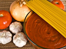 Spaghetti Sauce & Ingredients. Spaghetti sauce in a bowl with other ingredients royalty free stock image