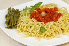 Spaghetti with sauce and salad leaves. Stock Image