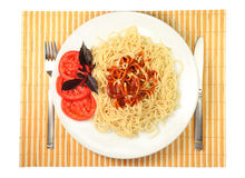 Spaghetti with sauce and tomato. Basil Stock Photography