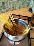 Spaghetti. In saucepan of boiling water on gas stove Royalty Free Stock Photos