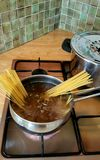 Spaghetti. In saucepan of boiling water on gas stove Stock Photo