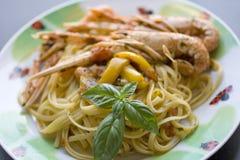 Spaghetti with scampi Stock Photos
