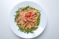 Spaghetti with ham and argula stock images