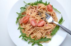 Spaghetti with ham and argula royalty free stock image