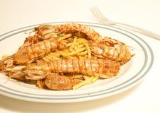 Spaghetti with sea mantis Stock Images