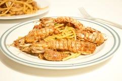 Spaghetti with sea mantis Royalty Free Stock Image