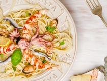 Spaghetti seafood with anchovy and baby octopus, close up Royalty Free Stock Image