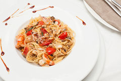 Spaghetti with seafood and cherry Royalty Free Stock Images